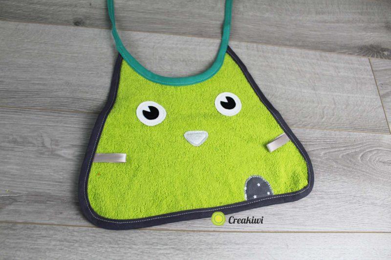 Bavoir pour enfant créature verte Creakiwi